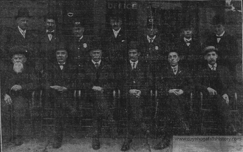 "The top row from L to R: City Clerk Clarence D. Crumb, Street Commissioner Frank S. Craig, Marshal C.J. Shoaf, Mayor C.A. Davis, Night Marshal Davis, Legal Adviser D.F. Felmly, and Health Officer/Poor Director/Cemetery Trustee W.W. Scupholm. Seated in the second row are the 'city fathers ""whom people generally roast when often-times not thoroughly acquainted with matters being considered by the dads. They are: Edgar A. Inskeep, David Brown, Henry Merritt, D.W. Fretz, Walter Wainwright and W.M. Stanley. Not pictured is the Genial Treasurer, John R. Porter."